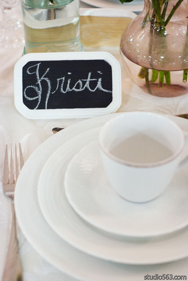 Shabby Chic vintage wedding place setting with chalkboard place cards and milk glass china. Photo by Studio 563
