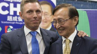 Ontario PC Leader Patrick Brown, left, puts his arm around newly elected…