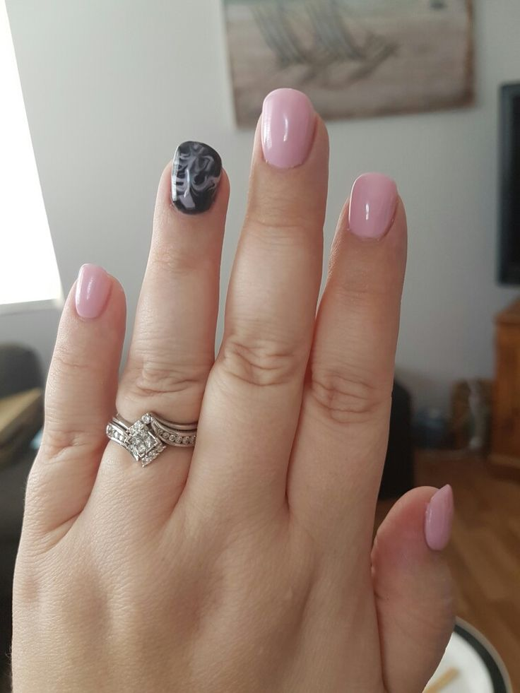 light pink and black swirl nails
