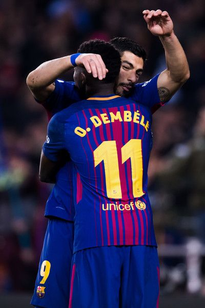 deb0b50a097 Luis Suarez of FC Barcelona celebrates with his teammate Ousmane Dembele  after scoring his team s sixth goal during the La Liga match between Barcelona  and ...