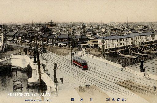 A streetcar crosses Nihonbashi bridge, the white buildings on the right constitute the fish-market, ca 1910s.