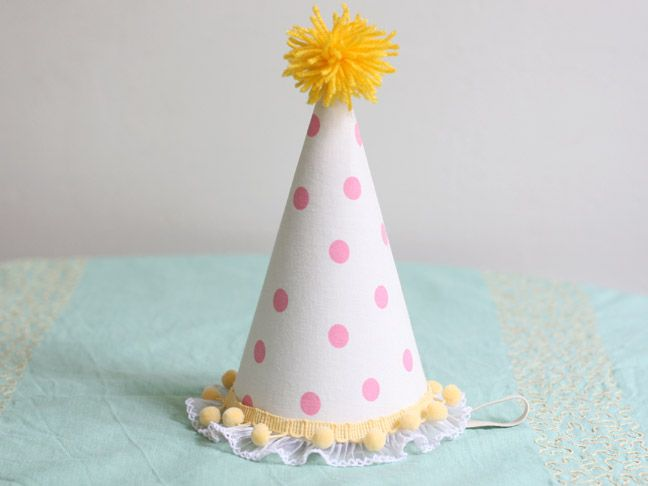 Tutorial includes how to make the pom pom at top...might be a cute touch with a fabric ruffle at the bottom!  Now to decide whether to use fabric or scrapbook paper?
