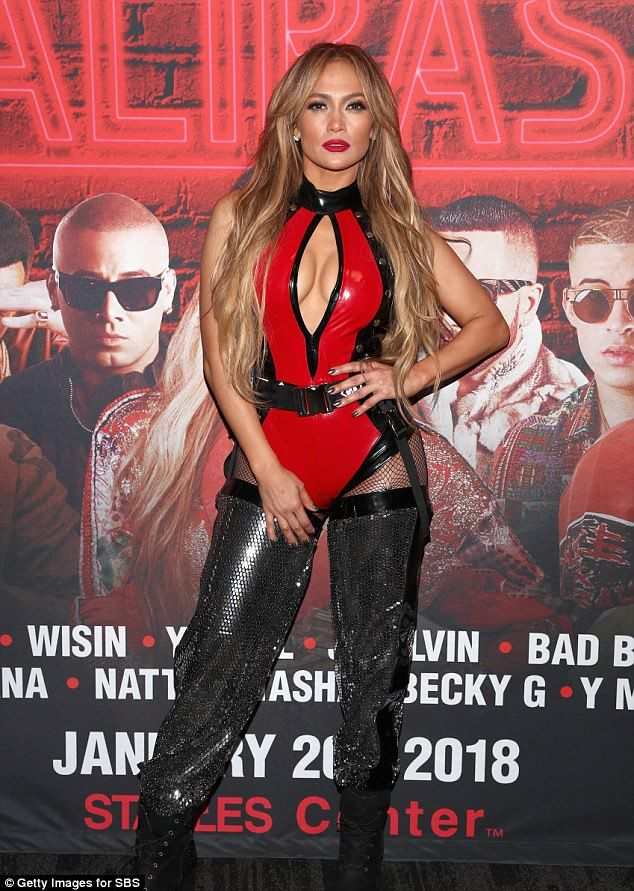 Youthful: Jennifer Lopez, 48, showed off gravity-defying cleavage in a plunging PVC red co...