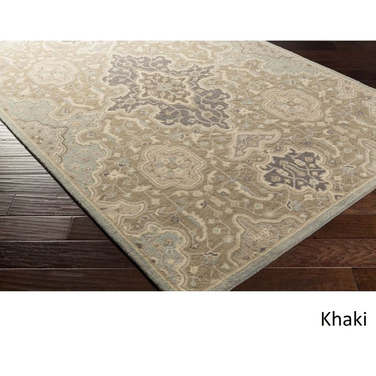 Add a touch of elegance into your home with this beautiful hand tufted damask rug. Featuring a 100-percent wool construction, it offers comfort and durability and is sure to add something special to your decor.