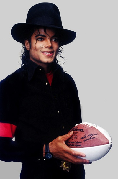 Michael Jackson in a hat with a football