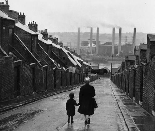 Bert Hardy - Newcastle Street. A woman and child walking down a Tyneside street, in Newcastle, England, 1950.