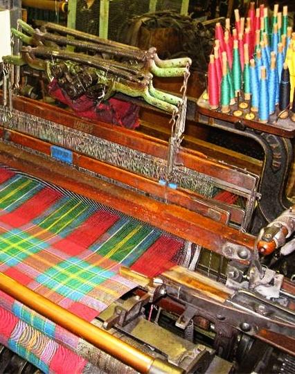 Loom in Scotland in the process of making the new 'Ellis Island' tartan ❥