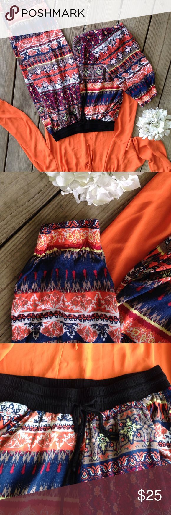 Indian Print Jumper Pants (Elastic Ankles) Medium Size medium, orange, White, Royal, black, brown, maroon make up this Indian print. Elastic bottom cuffs. Drawstring elastic waist. Free gift with purchase Pants Ankle & Cropped