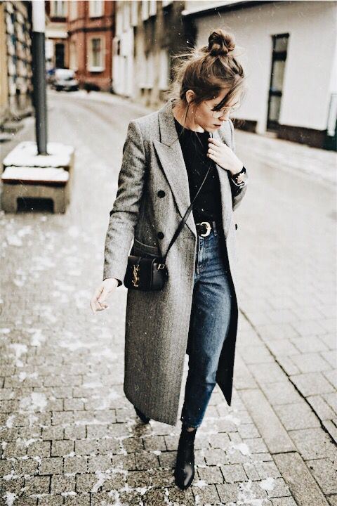 Long gray wool coat with a black sweater, blue jeans and booties