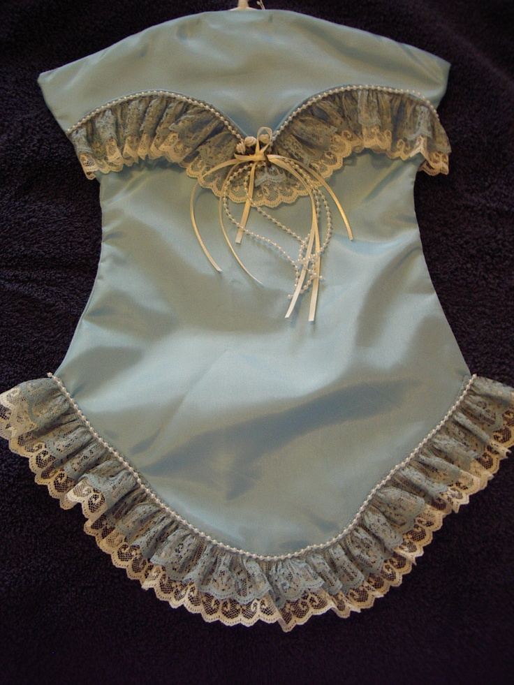 Light blue taffeta trimmed in tiered blue on white lace with bead trim. This is a Lingerie Keeper I made.  It opens along the bustline to a full length pocket. This could also be used as a Santa Stocking for hiding Christmas goodies.