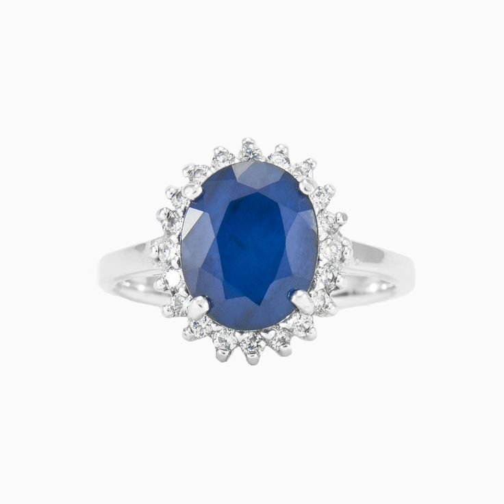 A beautiful, classic ring in sterling silver with oval cut Sapphire surrounded by crystals.