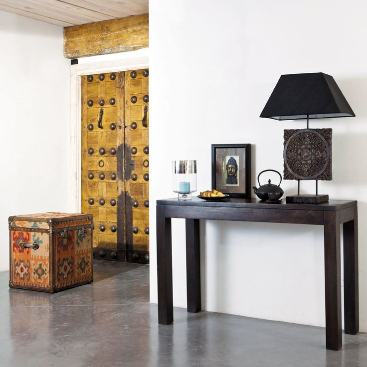 Trunk Kilim: Take your design on a journey with the Kilim trunk. This wonderful cotton fabric trunk is covered with a multicoloured ethnic motif. Used as a side table, bedside unit or chest, this large trunk adds an exotic touch to your interior. The framed Buddha and black decoratives and the accented door add a classy look