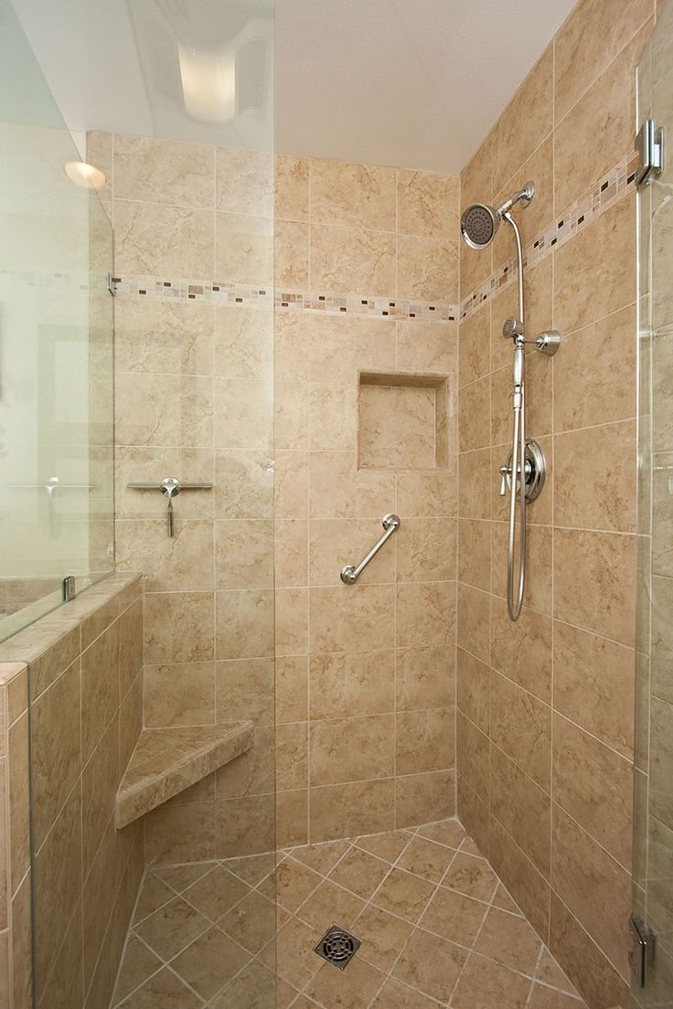 redoing bathroom%0A A traditional bathroom remodel by One Week Bath features a dark wood shaker  style vanity and step in bathtub with a separate glass door shower