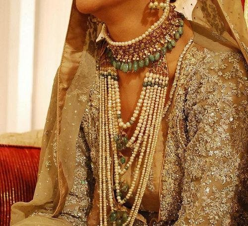 Cream, gold & jade statement pieces. stunning!
