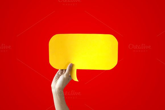 Human Hands Holding Yellow Speech Bubble Over Red Background - Balloon speech bubble concept  @creativework247