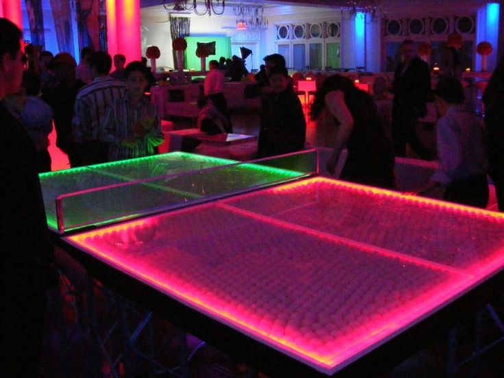 Glow in the Dark Ping Pong from #1 Interactive Entertainment Concepts.  Another fun use for EL wire!  :)