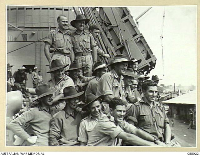 HAMILTON WHARF, BRISBANE, QUEENSLAND. 1945-03-29. HEADQUARTERS 1 BASE SUB-AREA TROOPS ON THE MAIN DECK ABOARD HMAT DUNTROON DURING THEIR EMBARKATION.