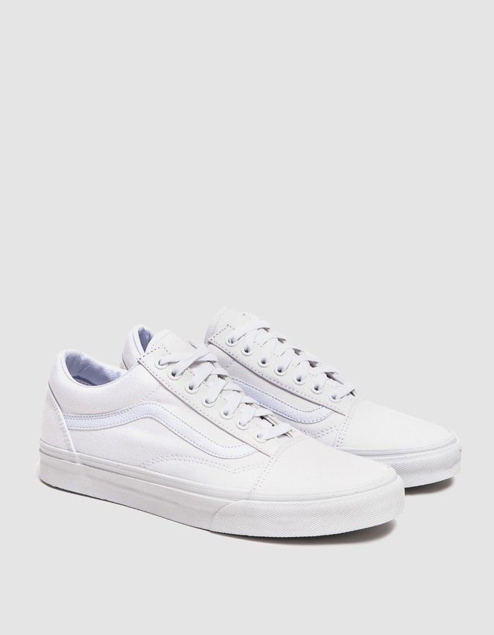 15ff0b38b509 Classic Old Skool from Vans in True White. Lace-up front with flat woven  laces. Padded collar. Tonal eyelets and stitching. Reinforced toe cap.