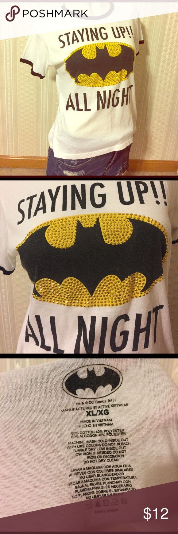 "Batman Tee!! For all of you Batman lovers out there! ""Staying up all night"" tee is so cute! The front is full of yellow/gold rhinestones! It's a size XL and it's true to size. I'm a Large and I love how it fits me (slightly slouchy). Believe it will fit a Medium as well, just more of a loose tee-shirt fit. This is in flawless condition! And it is so soft that I could sleep in it (but I didn't). Kinda see-through, so you might have to layer it up DC Comics Tops Tees - Short Sleeve"