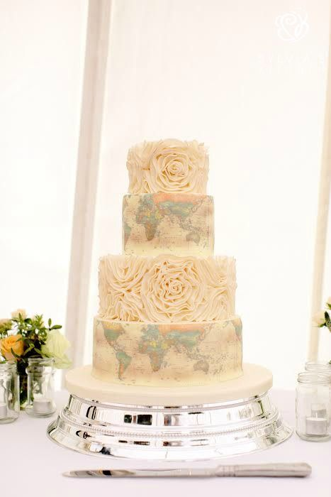www.sylviaskitchen.co.uk  four tier world map style cake with sugar ruffles image by Rebecca Goddard Photography