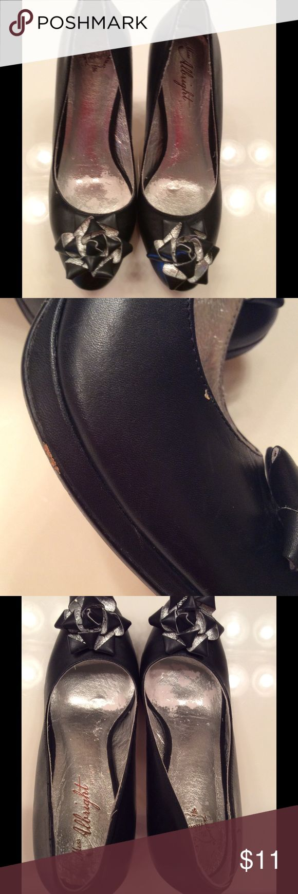 Cute black and silver high heel shoes In good condition but has some minor scratches one of the shoe. Pictures are posted. Please let me know if you have any questions. The shoes are size 8 but being honest it's a very snug size 8. I want to say it's more like  7 in a half. But I am not familiar with the brand Miss Albright  Shoes Heels