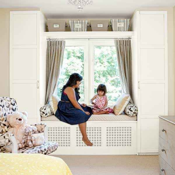 Use Ikea wardrobe units to create built-ins around a window seat.