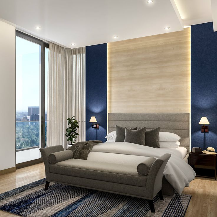 Modern master bedroom styled with royal blue