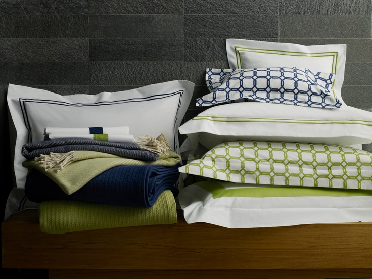 Italian-printed and -woven SFERRA bedding ensemble Barrington shown with Orlo appliqué and Grande Hotel bed linens, Grant cotton blanket, and best-selling Celine brushed cotton throw--all in Chartreuse or Navy.
