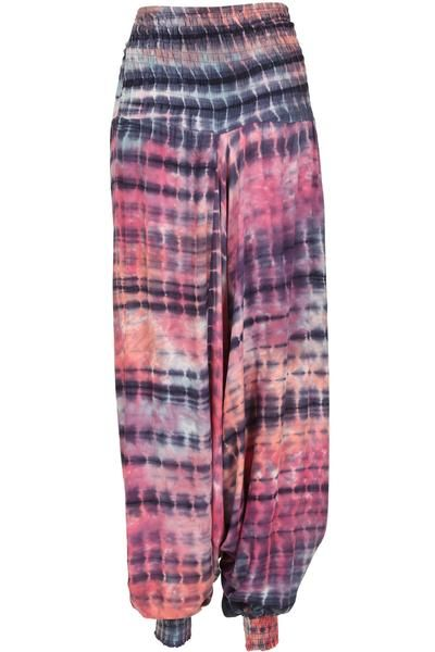 A pair of harem style pants in a colourful tie-dye print. A deep defined waistband flatters the tummy area with bow detailing adding interest. Loose cut legs ma