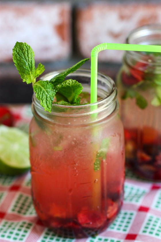 Fresh Cherry Mojitos (1/2 cup sugar    1/2 cup water    1 lb sweet cherries, pitted and roughly chopped        1 tbsp minced fresh mint      juice of 1 lime     2 oz light rum     8 oz sparkling water each)