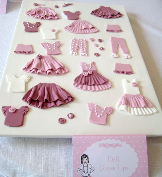 How nice is this idea????  paper doll party-fondant clothes for paper doll cookies....you could do mini cakes for each girl and let them play dolls on the cake...