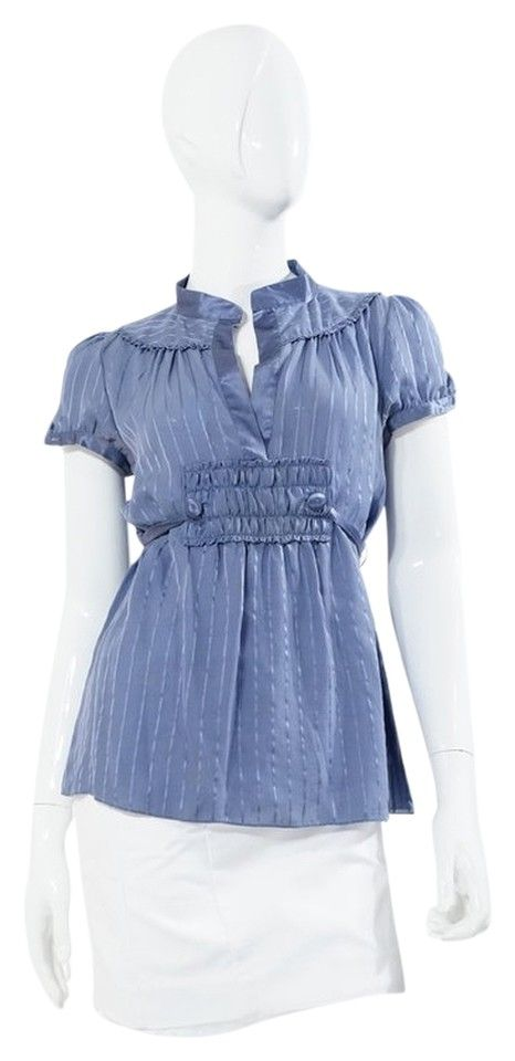 """Marc Jacobs Blue Striped Semi Sheer Short Sleeve Blouse. Size US 2. Tone on Tone Blue striped silk chiffon short sleeve blouse, mandarin satin collar, satin covered button detailing, satin tie back accent, ruched bib and trim. 100% Silk, Dry Clean Only. Excellent gently used condition with light overall wear and minor wear under arms and some makeup staining to collar (would most likely clean out). Bust 32"""", Length 30"""". Retail $149.00"""
