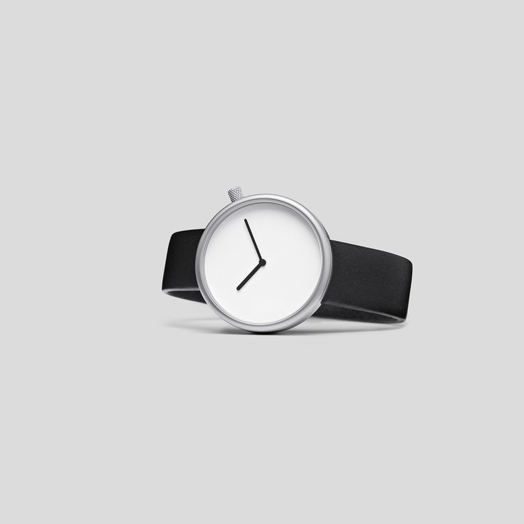 MATTE STEEL ON BLACK, ITALIAN LEATHER.  Following the slightly asymmetric Pebble and the clean and contemporary Facette, the circular, minimalist Ore watch reduces timekeeping to its pure essence.