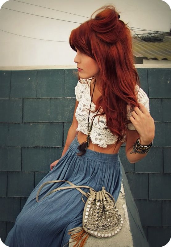 The crop top and maxi skirt, the wooden and chained bracelets and feather necklace. YES! Love this style