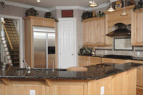 Maple With Black Granite Counter Backsplash Is Neutral
