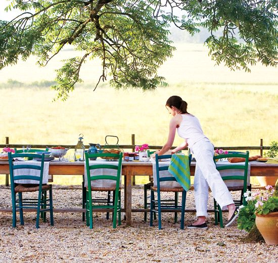 French country style - What's more relaxing than a French country style brunch in the open air? We can't all escape to Toulouse for a fresh meal, but you can get this look by leaving your wood furniture outside to get weathered and placing small, simple bunches of flowers in water glasses or bud vases.