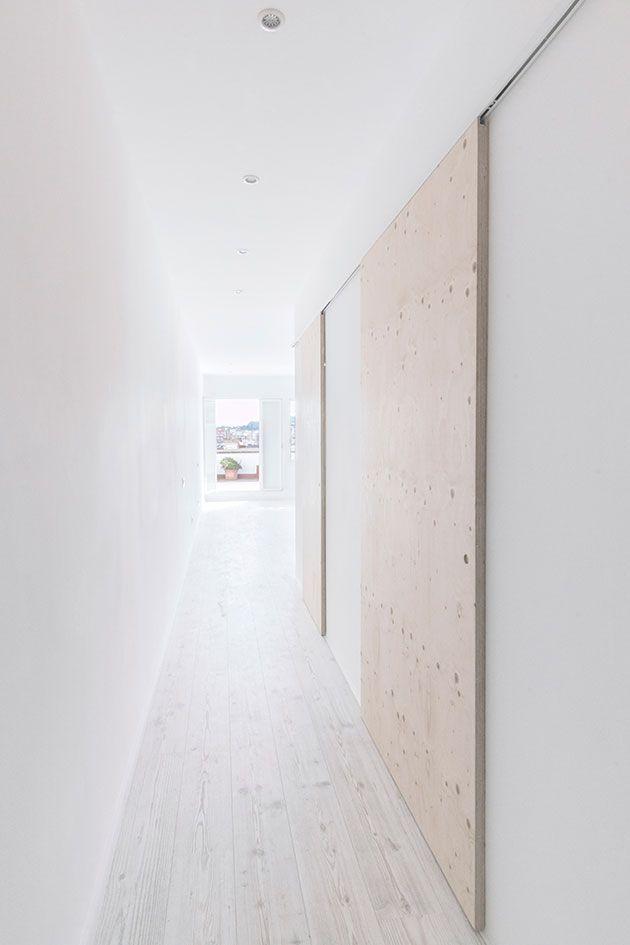 Very flat siding doors. Tv hiding?THEHALLSTUDIO                                                                                                                                                                                 Más