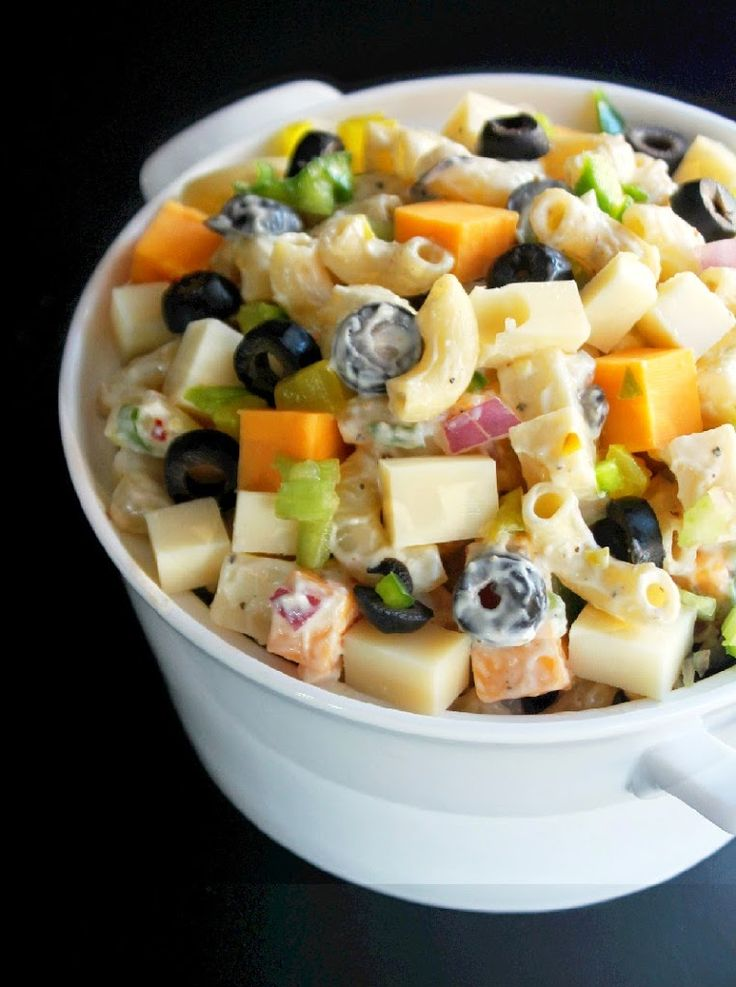 Cheesy Picnic Pasta Salad _ My Salad is loaded with four cheeses, yes four. I added Swiss, Cheddar, Jack and Parmesan. Next, for the veggies, I went with sliced black olives, dill pickles, bell peppers, red onion, garlic and celery - Creole Contessa