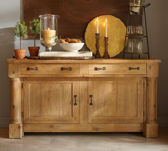 """Charles Buffet from Pottery Barn. This substantial buffet takes inspiration from an early 19th century English refectory sideboard. Large half barrel columns anchor the framework and lend a distinctive look. Crafted of solid hardwood, MDF, and veneer. Multistep finish is stained and sealed for protection. Features 2 cabinets, 2 drawers, and 2 adjustable shelves with 3 adjustable heights, and half moon cutouts for wire management. 70""""W x 19""""D x 36""""H. $1899.00. On sale now for $1699.00"""