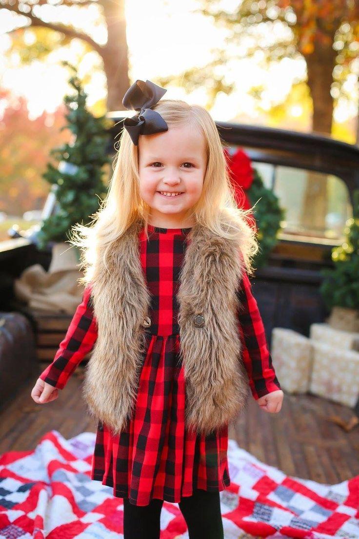Christmas photo, buffalo plaid, fur vest, toddler girl Christmas Photographer: Megan Wilson, Wild Light Creative