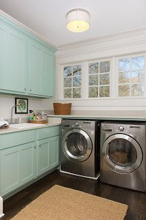 Aqua painted cabinets in laundry room, because it's easier to change those later than the washer/dryer (fourhouses)