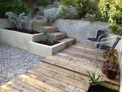 Reclaimed scaffold board decking, rendered raised beds