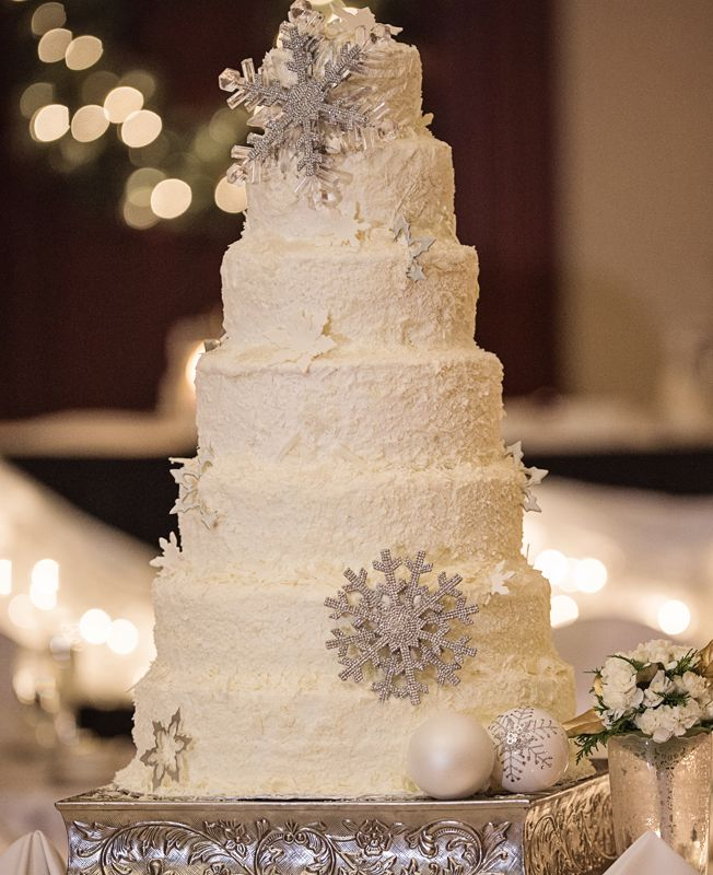 Look for elegant snowflake Christmas ornaments to use for this simple, clean lined Winter wedding cake | Weddings by Sal & Bella| From: Blog.TheKnot.com #winter #weddings #silver