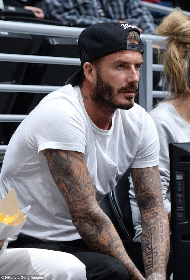 Hunky: David Beckham, 40, put on a smouldering display as he watched the Los Angeles Kings...