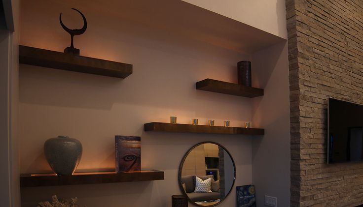 Renovare Model Home. Floating shelves in the kitchen share form and function.
