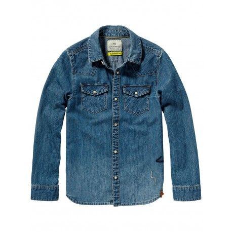 CAMICIA IN JEANS SCOTCH SHRUNK Camicia da bambino della Scotch Shrunk in blu jeans con abbottonatura frontale con bottoni in madreperla button-up, colletto button down, due tasche con patta e piccoli dettagli decorativi ricamati. Camicia in jeans Scotch Shrunk in stile western per tutte le occasioni. #scotchskrunk #scotchsoda #camicia #shirt #abbigliamento #bambino #ragazzo #bimbo #boy #baby #kid #junior #child #children #denim #shoponline #ecommerce #fashion #moda #saldi #sconti #promozioni
