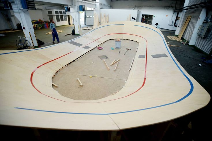 Velodrom Nowe Dynasy - Studio Robot project. The design and creation of a mini velodrome aiming at promotion of cycling and cycling  tournaments. Its creation was possible thanks to online crowdfunding via polakpotrafi.pl. The purpose of the project was to back the revitalization and breathe new life into an obsolete and forgotten, full-sized Nowe Dynasy velodrome on Poskarbinska street in Warsaw. The raceway consists of 10 modules, which faciliates transport and usage where applicable.