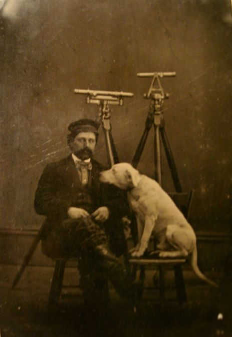 Occupational photograph of a land surveyor with his dog, ca. 1860s.