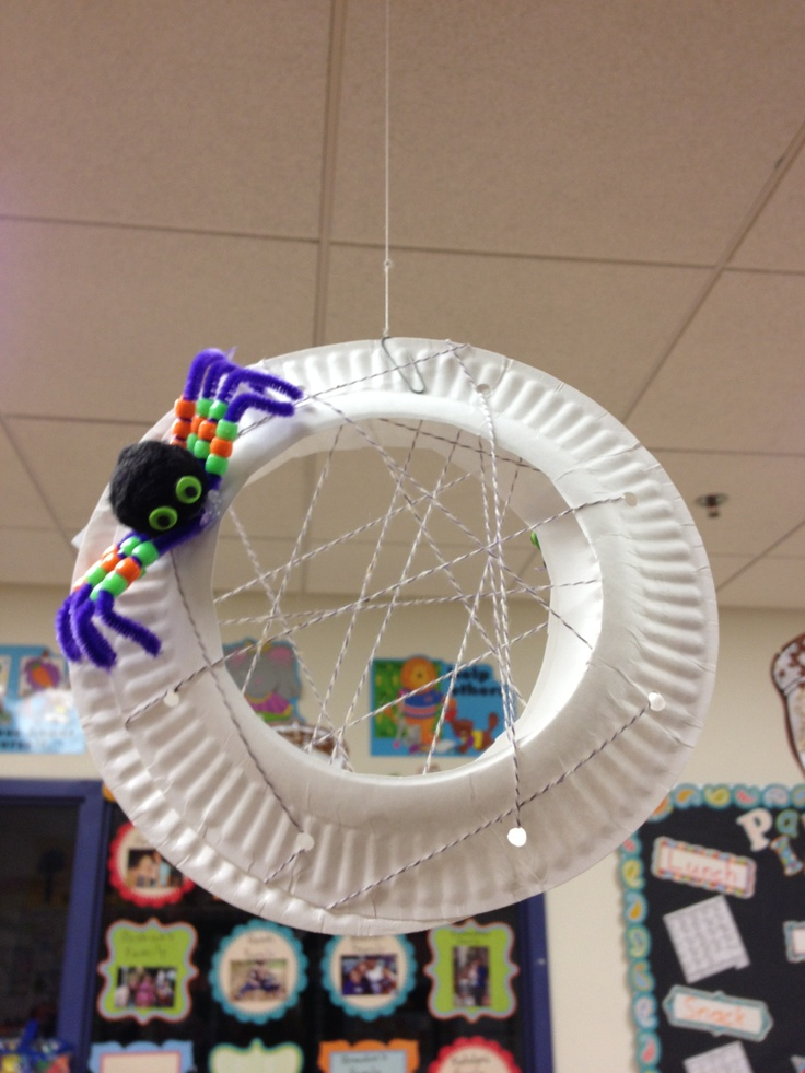Fine motor activity: kids lace beads on pipe cleaner legs on spider and lace string through cut paper plate for web.