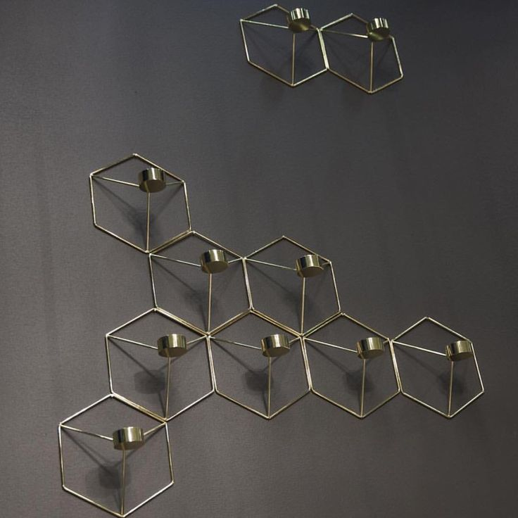 MENU POV Wall Candleholders (tea lights) in a brass finish, available in our Candles & Candleholders section www.obtaindesign.com.au #decor #design #danishdesign #scandinavian #candleholder #brass #menu #homedecor #designstore